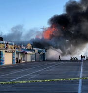 Firefighters battle a blaze Saturday that destroyed a building used by Playland's Castaway Cove and two other businesses on Ocean City's boardwalk.