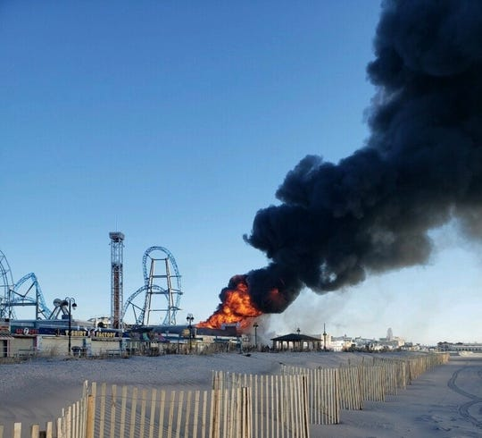 A four-alarm fire sent flames and smoke above the boardwalk in Ocean City Saturday.