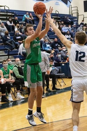 Huntington senior Gavin Free attempts a jump shot to score against Adena during a game in Frankfort, Ohio, on Friday, Jan. 29, 2021.