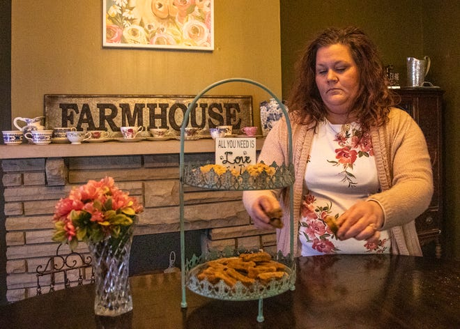 Heather Lynch arranges dog treats on a show platter inside her home in Chillicothe. Lynch creates all-natural products for people's pets.