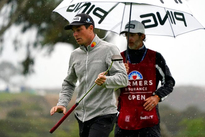 Viktor Hovland, left, of Norway, waits to putt on the eighth hole of the South Course during the second round Friday of the Farmers Insurance Open golf tournament at Torrey Pines in San Diego.