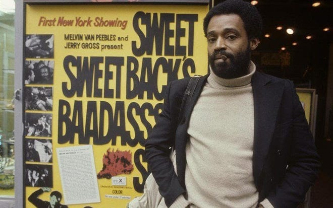 Melvin Van Peebles in front of an advert for his film.