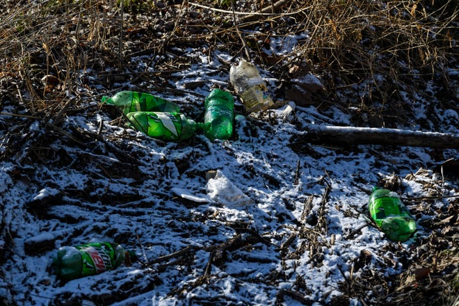 """Trash is strewn on the side of Stratman Road in Henderson, Ky., Friday, Jan. 29, 2021. """"Our community is a reflection of all of us,"""" Nancy Watkins, Henderson County Solid Waste Coordinator, said. """"And we need to try to keep it clean."""""""