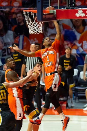 Jan 29, 2021; Champaign, Illinois, USA; Illinois Fighting Illini guard Trent Frazier (1) shoots against the Iowa Hawkeyes during the first half at the State Farm Center.