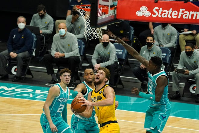 Indiana Pacers forward Domantas Sabonis (11) goes up for a shot covered by Charlotte Hornets forward Miles Bridges (0) during the second quarter at Spectrum Center.
