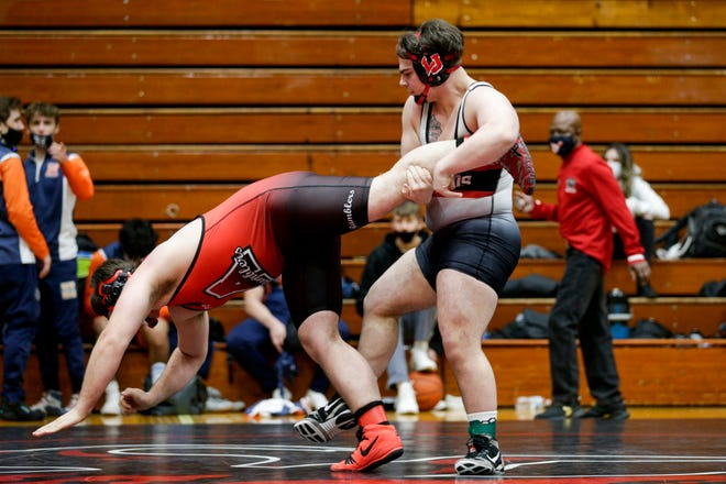 Lafayette Jeff's Jacob Raub, right, wrestles Attica's Clayton Sheets during a 220 pound championship bout in an IHSAA sectional wrestling match, Saturday, Jan. 30, 2021 in Lafayette.