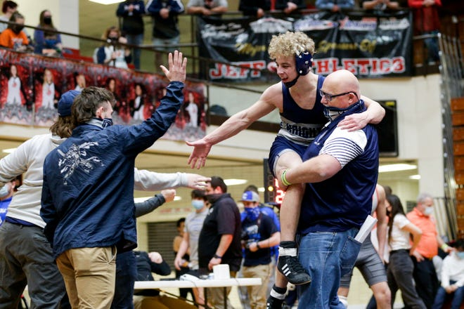Central Catholic head coach Pat O'Keefe hoists Andrew Kline after Kline defeated Carroll's Jackson Ayres during a 138 pound championship bout in an IHSAA sectional wrestling match, Saturday, Jan. 30, 2021 in Lafayette.