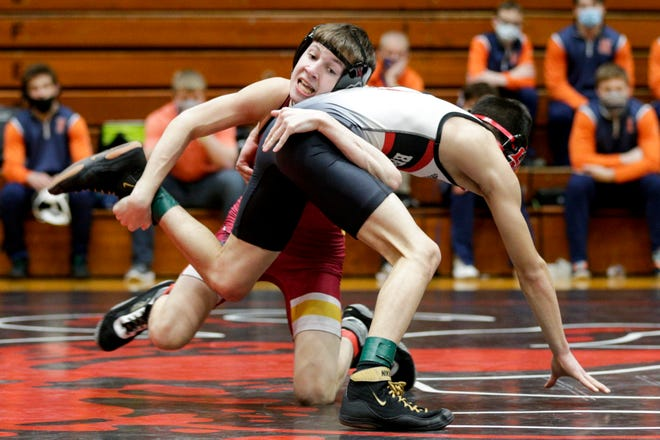 McCutcheon's Jake Stall, left, wrestles Lafayette Jeff's Alex Lopez, right, during a 106 pound championship bout in an IHSAA sectional wrestling match, Saturday, Jan. 30, 2021 in Lafayette.