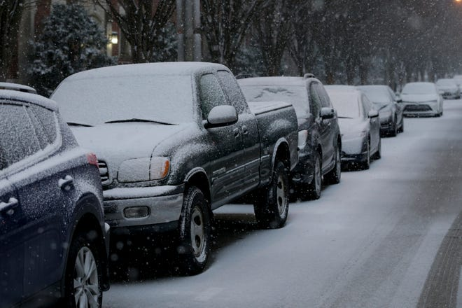 Snow begins to cover cars parked at Purdue University, Saturday, Jan. 30, 2021 in West Lafayette.