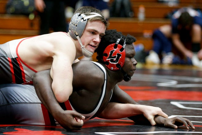 West Lafayette's Connor Barket, top, wrestles Lafayette Jeff's Daeveon Cheeks, bottom, during a 195 pound championship bout in an IHSAA sectional wrestling match, Saturday, Jan. 30, 2021 in Lafayette.