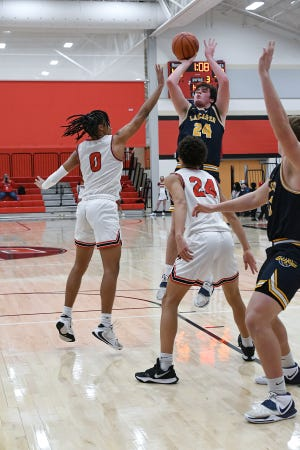 Lancaster's Sam Fink shoots the ball Friday night at Groveport Madison. The visiting Gales lost 59-52.