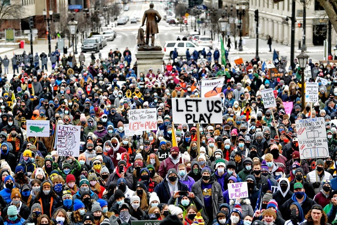 "A large group participates in the ""Let Them Play"" rally on Saturday, Jan. 30, 2021, at the Capitol in Lansing. The rally was aimed at getting high school athletes back in action for winter sports."