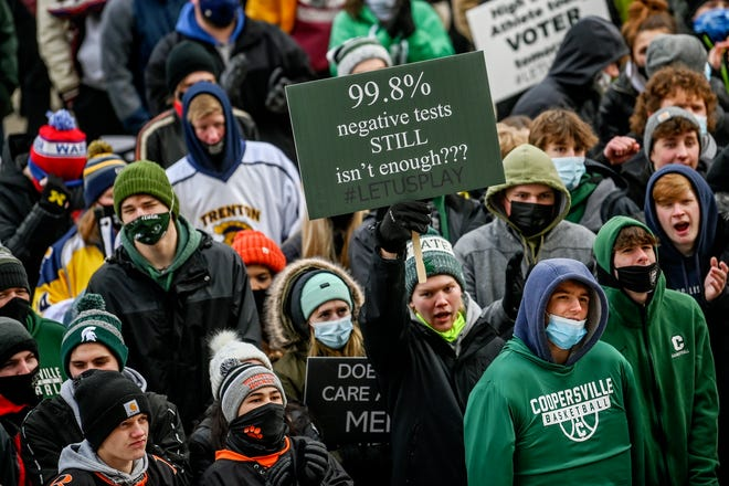 """Student athletes participate in the """"Let Them Play"""" rally on Saturday, Jan. 30, 2021, at the Capitol in Lansing. The rally was aimed at getting high school athletes back in action for winter sports."""