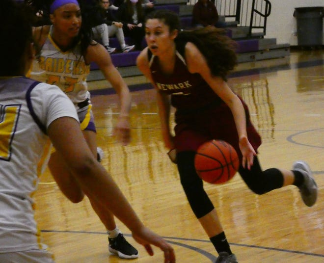 Emma Shumate (5) of Newark, player of the year in Division I