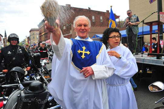 Rev. Msgr. Mark J. Giordani, a biker himself, blesses the riders during the annual 45th Motorcycle Blessing in Paterson, NJ, on Sunday, May 5, 2014.