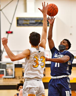 Dallastown's Michael Dickson, seen here at right in a file photo, reached the 1,000-point milestone for his career on Friday night.