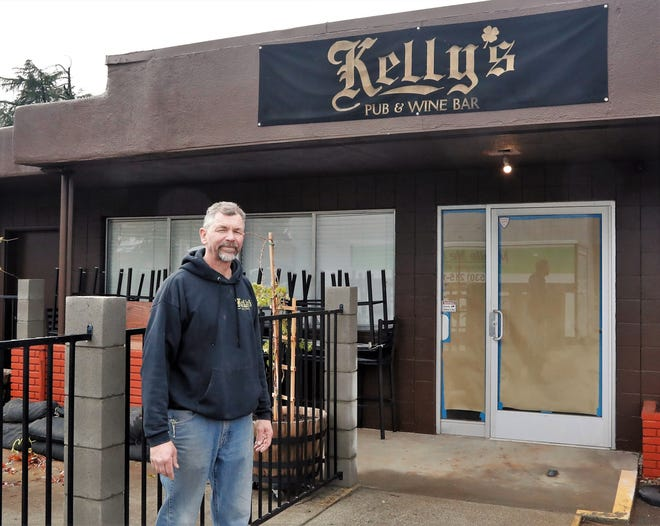 Robert Hanson stands in front of the soon-to-be new location of Kelly's Pub & Wine Bar at 2144 Hilltop Drive in Redding. Hanson and his wife, Rhonda, bought the business when it was located across the street. The new location will have greater outdoor seating, more indoor space and better visibility.