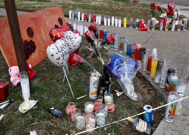 A candle- and flower-filled memorial sits at the corner of Olympus Avenue and Park Marina Drive in Redding on Friday, Jan. 22, 2021, in remembrance of the three men who died of a suspected fentanyl overdose earlier in the week. Friends held a candlelight vigil the previous night for Austin Tod Mclemore, 28, Rion Justin Bertz, 33, both of Redding, and Joshua Daniel Severson, 33, of Austin, Texas.