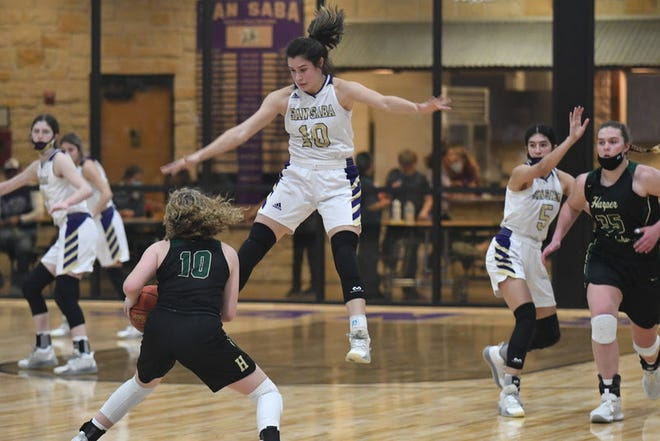 San Saba High School's Brighton Adams (10) and Nojemi Martinez (5) defend against Harper during a District 29-2A girls basketball game Friday, Jan. 22, 2021, in San Saba.