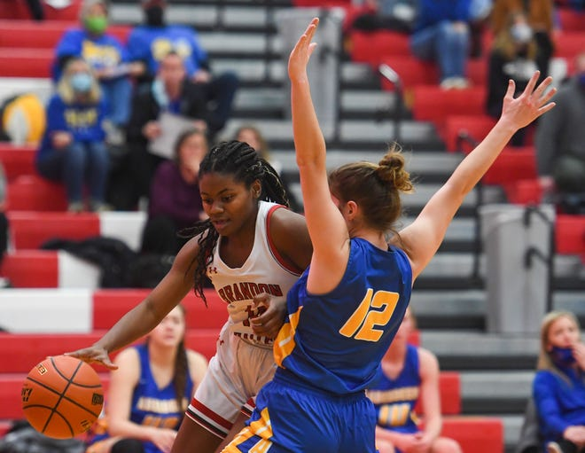 Brandon Valley's India Bradfield drives against Aberdeen Central's Taryn Hettich on Friday, Jan. 29, at Brandon Valley High School. The Lynx play Aberdeen Central again Thursday in the opening round of the state tournament.