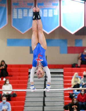 Lincoln's Elizabeth Boysen competes on the uneven bars in a gymnastics meet on Saturday, Jan. 30, at Lincoln High School in Sioux Falls.