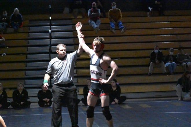 Hurricane's Josh Armstrong wrestles, and pins, Desert Hills' Keegan Boyce.