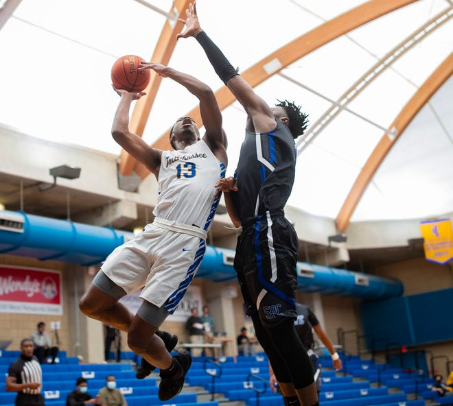 TCC Eagle Jeremiah Kendall (13) shoots for two. The TCC Eagles host the St. Pete Titans on Saturday, Jan. 30, 2021.