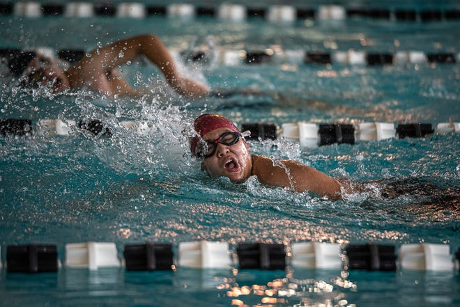 A swimmer competes in a 100-yard freestyle race. District 2-5A boys competed at a swim meet at the SISD Aquatic Center in El Paso on Jan. 29, 2021.