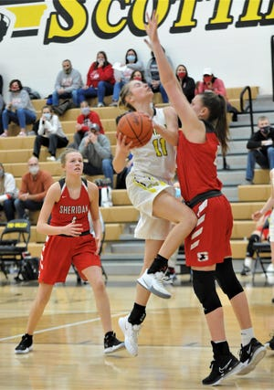 Tri-Valley's Riley Tracy drives against Sheridan's Faith Stinson in Saturday's game. The Generals won 47-36.