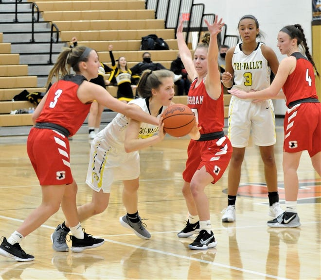 Tri-Valley's Anna Krupa is defended by Sheridan's Bailey Beckstedt (3) and Kinze Miller in Saturday's game where the Generals won 47-36. Both teams received top seeds in their respective districts during Sunday's tournament draw.