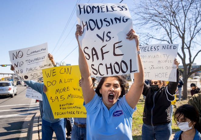 Rupal Chaudhari, a co-owner of Hampton Inn and Homewood Suites, joins in a Jan. 31 protest against a city proposal to buy the Candlewood Suites hotel on Pecan Park Boulevard to house homeless people.