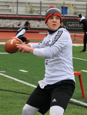 Five star quarterback Gunner Stockton drops to throw during a 7-on-7 practice.