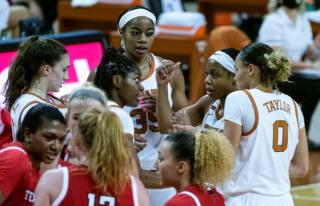 Texas point guard Kyra Lambert huddles with teammates Joanne Allen-Taylor, Shay Holle, Charli Collier and Celeste Taylor during Saturday's 72-53 win over Texas Tech. The Longhorns improved to 12-4 on the season.