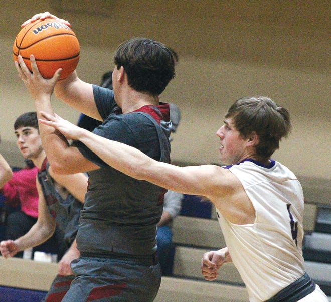 Wesleyan Christian School's Preston Francis, right, tries to disrupt a pass during last week's varsity boys basketball game against Barnsdall High.
