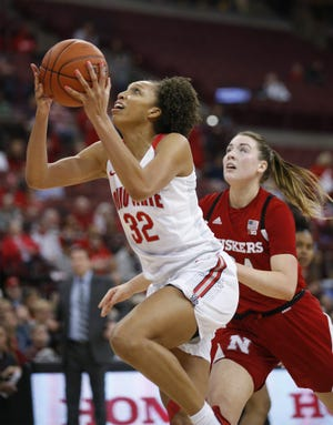 Ohio State forward Aaliyah Patty, left, is playing despite a recent shoulder injury.