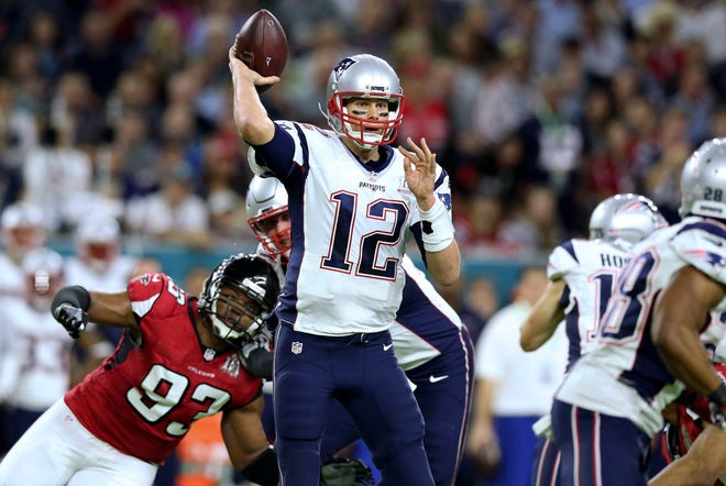 Tom Brady passes against the Atlanta Falcons during Super Bowl 51. The Patriots completed the biggest comeback in team history when they beat Atlanta, 34-28, in overtime.