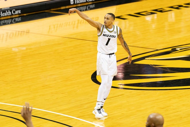 Missouri's Xavier Pinson watches a 3-point shot go in the basket during the second half against TCU on Saturday at Mizzou Arena.