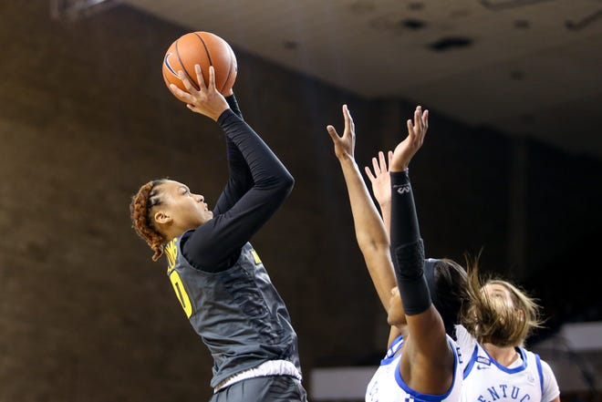 Missouri forward LaDazhia Williams (0) shoots the ball during a game against Kentucky on Sunday afternoon at Memorial Coliseum in Lexington, Ky.