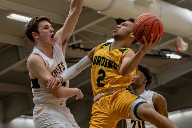 Rock Bridge's Xavier Sykes (2) drives to the hoop against Kickapoo during a Class 5 state quarterfinal game last March at Southwest Baptist University in Bolivar.