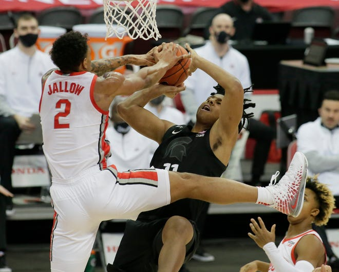Ohio State's Musa Jallow, left, competes for a rebound with Michigan State's A.J. Hoggard during the Buckeyes' 79-62 victory on Sunday.