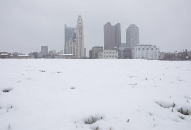 A blanket of snow covers the Columbus skyline in December 2020.