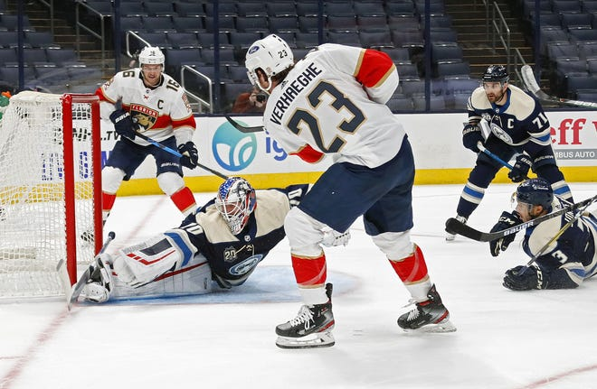 Blue Jackets goaltender Joonas Korpisalo makes the save on a shot by the Panthers' Carter Verhaeghe on Tuesday, when it was Korpisalo's turn to play in the goalie rotation.