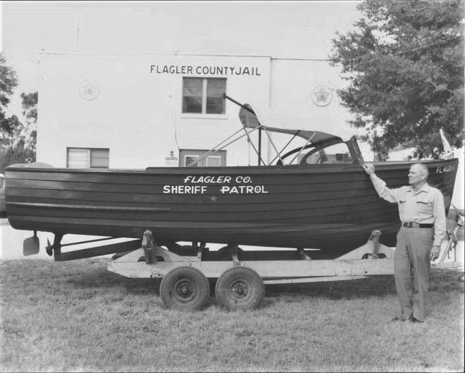Flagler County Sheriff Homer Brooks shows off the Sheriff's Office's patrol boat in the 1950s. Brooks, a U.S. Navy veteran of World War II, served as sheriff from 1957 to 1965. He died shortly into his third term as sheriff in 1965.