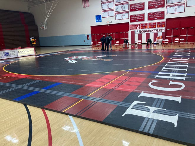 Edinboro University would be able to keep its athletic program, including its wrestling team, in the planned consolidation with Clarion and California universities of Pennsylvania.