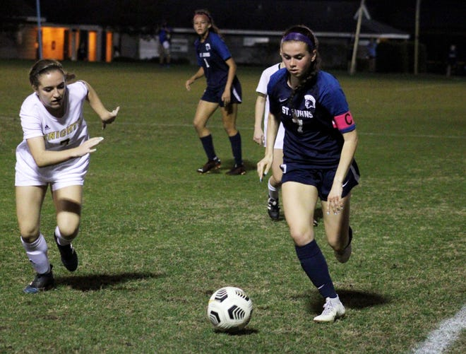 St. Johns Country Day midfielder Hannah Lemieux (right) dribbles along the sideline as Oakleaf defender Leigha Pecora pursues during Wednesday's game. St. Johns won 4-1 to complete a perfect regular season.