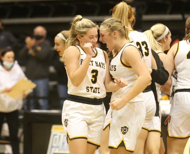 Tiger freshmen Sydney Golladay and Katie Wagner celebrate after Fort Hays beat Nebraska-Kearney 68-60 on Saturday at Gross Memorial Coliseum.