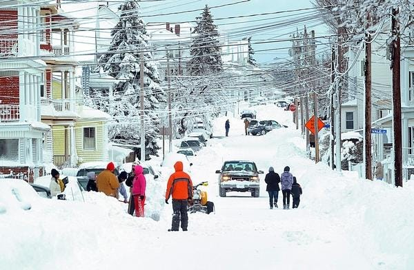 Residents of Palmer Street in Fall River dig out after a snowstorm in 2013.