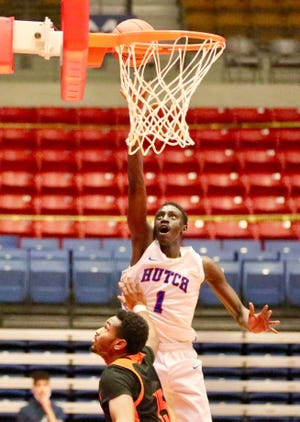 Hutchinson Community College's Majok Kuath (1) shoots over Neosho County's De'Antray Hughes (15) during their game Saturday night at the Sports Arena. HCC defeated Neosho 83-70.