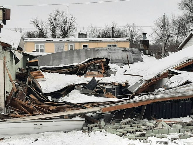 Wet and heavy snow on Sunday, Jan. 31, 2021, partially collapsed the roof at the Freeport Press at 1031 W. Empire St. The roof over the rear portion of the building caved in but the front office area was not damaged.