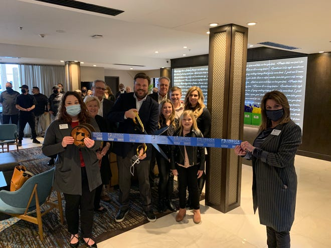 Ribbon cutting - DoubleTree By Hilton and Claraboya Restaurant & Bar, 505 Ave. Q. Holding scissors: owner Travis Stribling. Holding ribbon: Chamber Ambassadors Katy Townley, left, and Renee Payne. Also pictured: Kam, Casner, Eva, Hallie, Ben, Bob & Beverly Stribling, Chef Tony Pina, General Manager Matt Roig, and other staff, friends and Chamber Ambassadors.